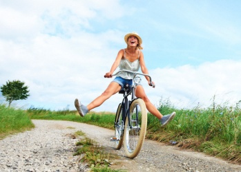 uplifting-woman-biking-free