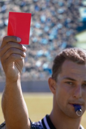 Soccer Referee Displaying a Red Card