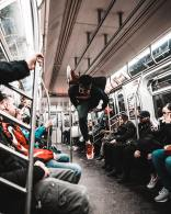 josh-gordon-breakdance flip in Subway-unsplash